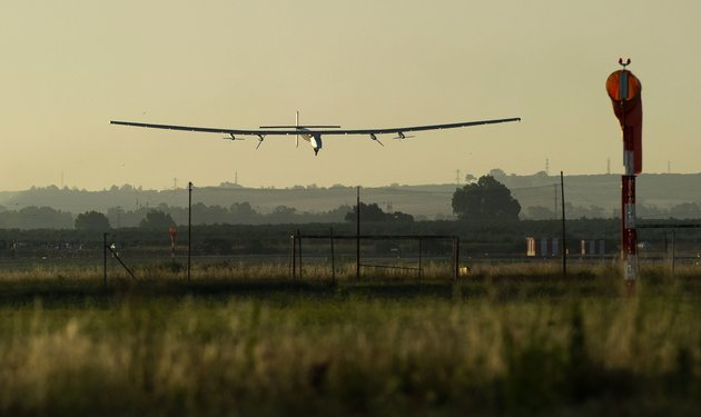 The sun-powered Solar Impulse 2 aircraft lands at Sevilla airport on June 23, 2016, after a 70-hour journey from New York powered only by sunlight. The sun-powered Solar Impulse 2 aircraft set off from New York's JFK airport early June 20, embarking on the transatlantic leg of its record-breaking flight around the world to promote renewable energy. The round-the-world solar flight is estimated to take some 500 flight hours and cover 35,000 km with Swiss founders and pilots, Bertrand Piccard and Andre Borschberg landing every few days to switch between piloting and hosting public events. / AFP / CRISTINA QUICLER (Photo credit should read CRISTINA QUICLER/AFP/Getty Images)
